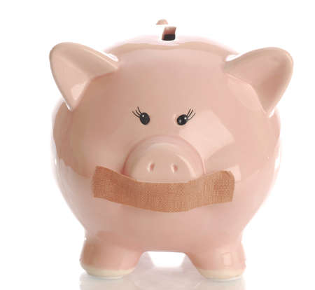 hushed: piggy bank hushed up with tape on mouth with reflection on white background