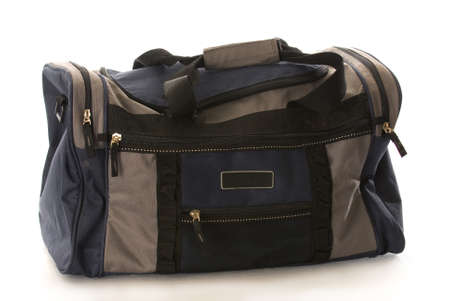 blue and grey duffel or luggage bag with reflection on white background