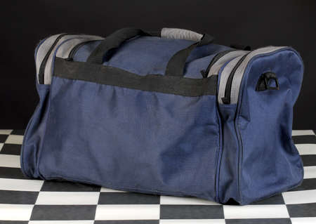 duffle: duffel or luggage bag with reflection on black background