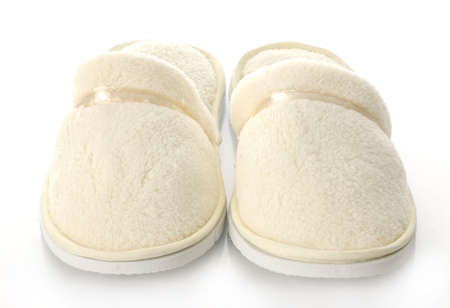 pair of womens fuzzy slippers with reflection on white background photo