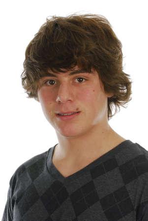 attractive teenage boy portrait on white background 写真素材