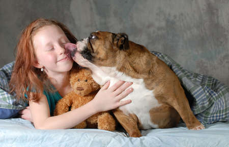 girl and her dog - pre teenage girl ready for cuddling with her dog  Banque d'images