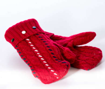 red winter mittens isolated on white
