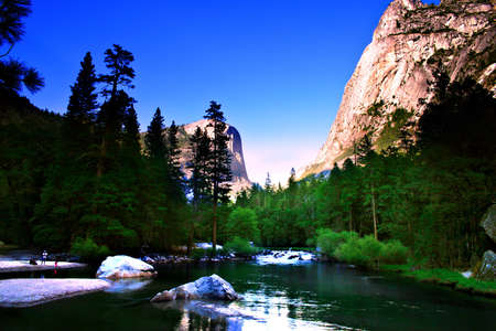 bridalveil fall: Reflection of the North Dome plays on the clear waters of the beautiful Mirror Lake   Stock Photo