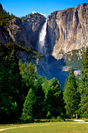 Yosemite Falls is the highest measured waterfall in North America. Located in Yosemite National Park in the Sierra Nevada mountains of California, it is a major attraction in the park, especially in late spring when the water flow is at its peak. Stock Photo - 614213