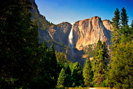 Yosemite Falls is the highest measured waterfall in North America. Located in Yosemite National Park in the Sierra Nevada mountains of California, it is a major attraction in the park, especially in late spring when the water flow is at its peak. Stock Photo - 614212