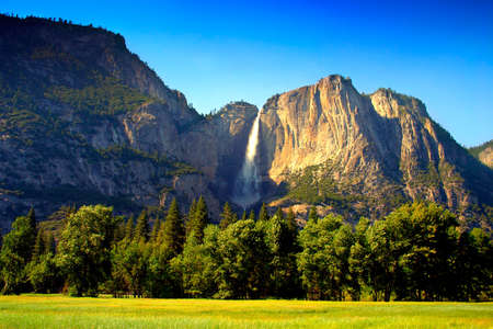 Yosemite Falls is the highest measured waterfall in North America. Located in Yosemite National Park in the Sierra Nevada mountains of California, it is a major attraction in the park, especially in late spring when the water flow is at its peak. Stock Photo - 614211