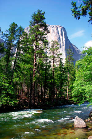 El Capitan is a 3,000 foot vertical rock formation in Yosemite Valley and Yosemite National Park. It is one of the most popular monoliths with rock climbers in the world. Stock Photo - 614155
