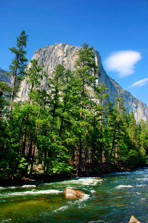 El Capitan is a 3,000 foot vertical rock formation in Yosemite Valley and Yosemite National Park. It is one of the most popular monoliths with rock climbers in the world. Stock Photo - 614152