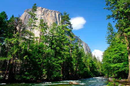 El Capitan is a 3,000 foot vertical rock formation in Yosemite Valley and Yosemite National Park. It is one of the most popular monoliths with rock climbers in the world. Stock Photo - 614151