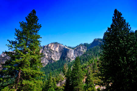 Tunnel View at Yosemite National park offers a beautiful panorama of Yosemite Valley with El Capitan on the left, Bridalveil Fall on the right and Half Dome in the center. Stock Photo - 614138