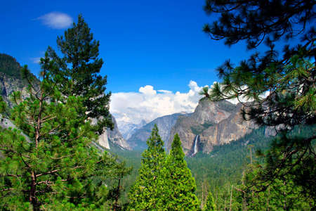 Tunnel View at Yosemite National park offers a beautiful panorama of Yosemite Valley with El Capitan on the left, Bridalveil Fall on the right and Half Dome in the center. Stock Photo - 614136