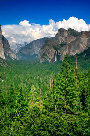 Tunnel View at Yosemite National park offers a beautiful panorama of Yosemite Valley with El Capitan on the left, Bridalveil Fall on the right and Half Dome in the center. Stock Photo - 614135