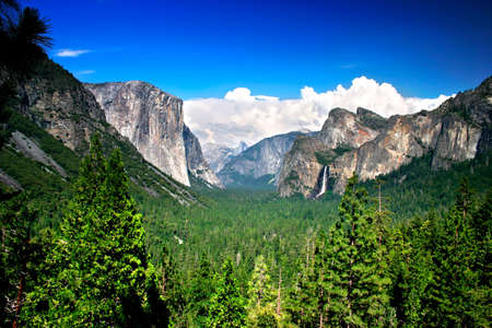 Tunnel View at Yosemite National park offers a beautiful panorama of Yosemite Valley with El Capitan on the left, Bridalveil Fall on the right and Half Dome in the center. Stock Photo - 614134