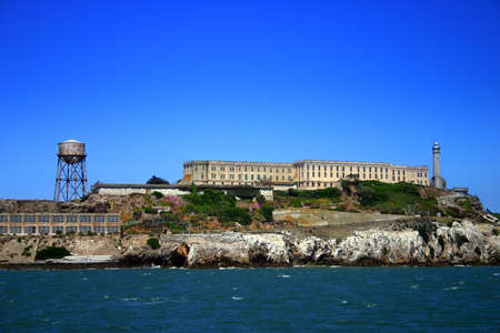 Alcatraz Island (some times referred to as The Rock) is a small island located in the middle of San Francisco Bay in California, United States that served as a lighthouse, then a military fortification, and then a federal prison for the area until 1969, w photo