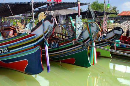 The Bangau Maritime Figureheads. Colorful pattern of traditional fisherman boats in Kelantan, Malaysia.   photo