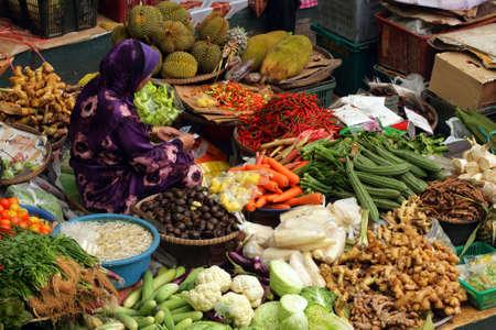 Muslim woman selling fresh vegetables at market in Kota Bharu Mal Stock Photo - 5558069