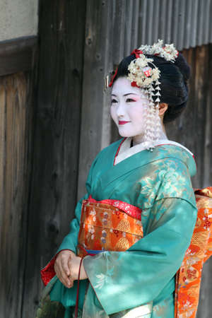 Maiko walking on a street (Kyoto, Japan)