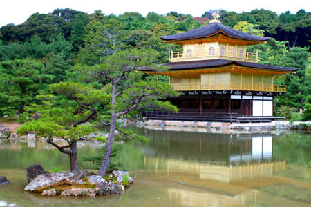 Kinkakuji (Golden Pavilion) is a Zen temple in northern Kyoto whose top two floors are completely covered in gold leaf.