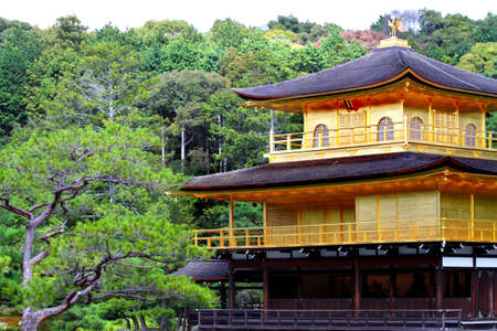Kinkakuji (Golden Pavilion) is a Zen temple in northern Kyoto whose top two floors are completely covered in gold leaf.  Stock Photo - 13768607