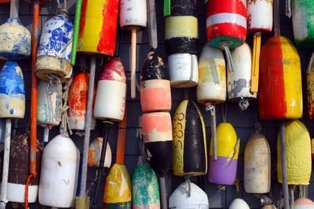 buoys: Buoys on the side of a beach shack
