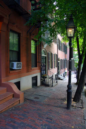 rowhouses: Beacon Hill is a wealthy neighborhood of Federal-style rowhouses, with some of the highest property values in the United States   Editorial