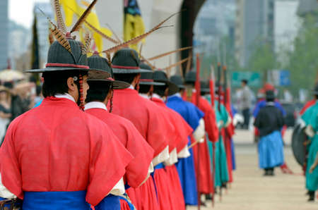 Row of armed guards in ancient traditional soldier uniforms in the old royal residence, Seoul, South Korea