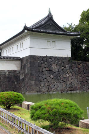 moat wall: The current Imperial Palace (Kokyo) is located on the former site of Edo Castle, a large park area surrounded by moats and massive stone walls in the center of Tokyo