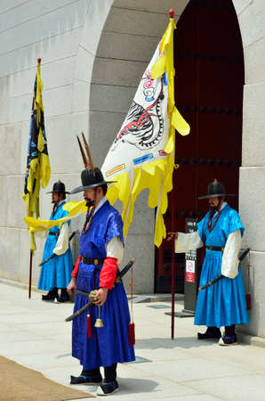 pageant: Row of armed guards in ancient traditional soldier uniforms in the old royal residence, Seoul, South Korea
