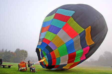 mid distance: Colorful Hot air balloons preparing for flight in Vermont Editorial
