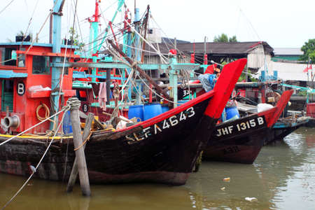 lake dweller: Colorful chinese fishing boat resting at a Chinese Fishing Village, Sekinchan, Malaysia