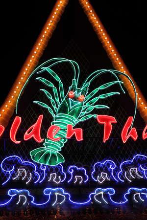 sameness: Stock image of neon sign of seafood restaurant Stock Photo