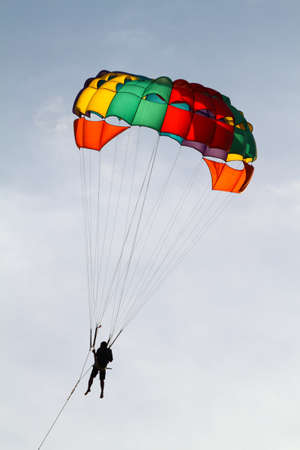towing: Stock image of parachuting over a sea, towing by a boat
