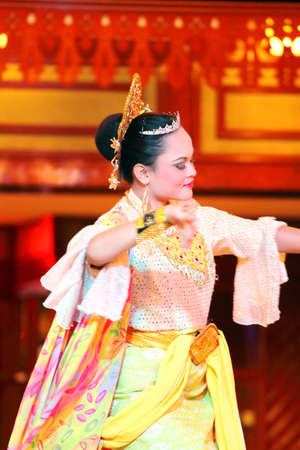 A Beautiful Malay woman with traditional cloth performing a dance