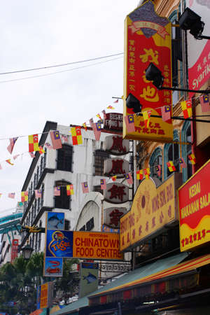 counterfeit: Petaling Street is a long market which specialises in counterfeit clothes, watches and shoes. Famous tourist attraction Editorial