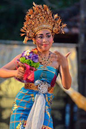 Young Balinese female dancer performing traditional dance