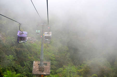 ferrying: Cable car ferrying passengers up and down the mountain Editorial
