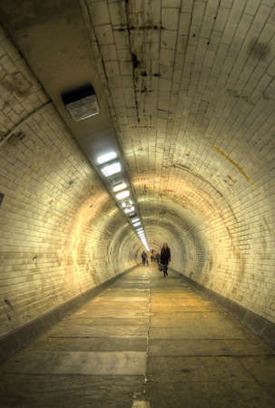 greenwich: The Greenwich Foot Tunnel crosses beneath the River Thames in East London, linking Greenwich in the south with the Isle of Dogs to the north Stock Photo