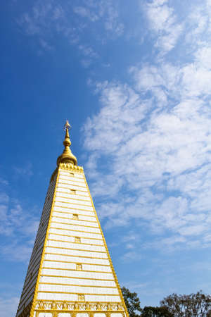 White pagoda with colorful blue sky in the northeast Thailand photo