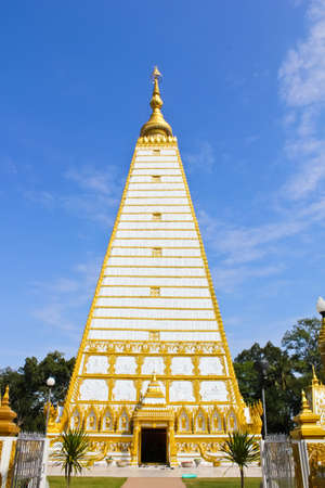 White pagoda with colorful blue sky in the northeast Thailand front view photo