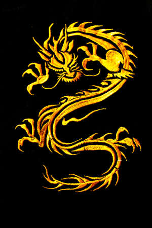 Golden dragon with black background Stock Photo - 9088786