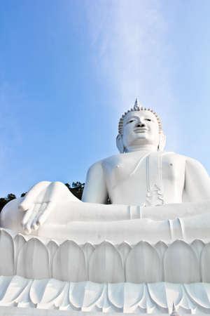 godhead: White Buddha with blue sky Stock Photo