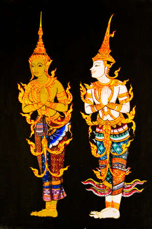 thai culture: Two angel painting with black background Stock Photo