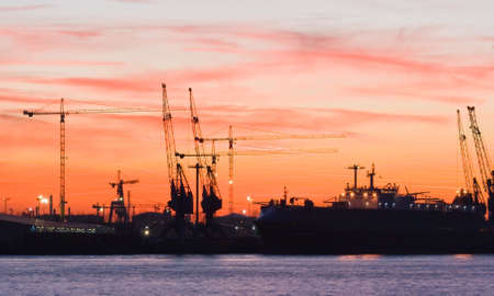 shiprepair: Silhouettes of cranes in the harbour by evening light
