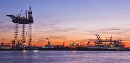 shiprepair: Drilling platform in repair in the harbour at sunset