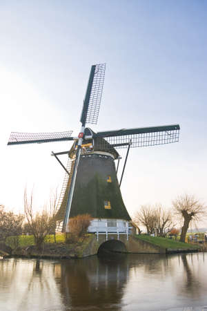 Dutch windmill in frozen winter landscape on a sunny afternoon Stock Photo - 4227752