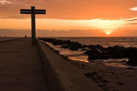 Pier and beach Hoek van Holland Netherlands at sunset Stock Photo - 4312494