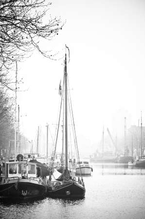 Ships with reflection in port- black and white image photo