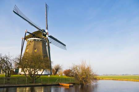 polder: Dutch polder landscape with windmill on sunny winter day