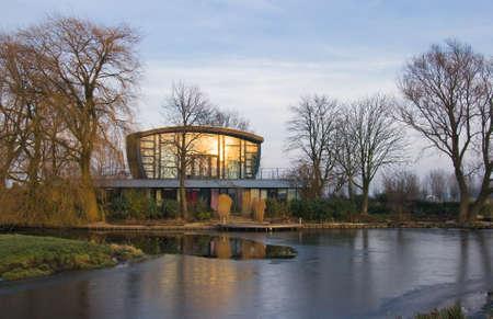 polder: Modern house in winter in Dutch polder at sunset Stock Photo